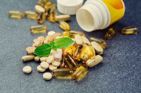 Group of different pills and multivitamins